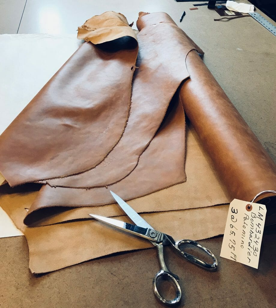 Roll of Leather and Scissors
